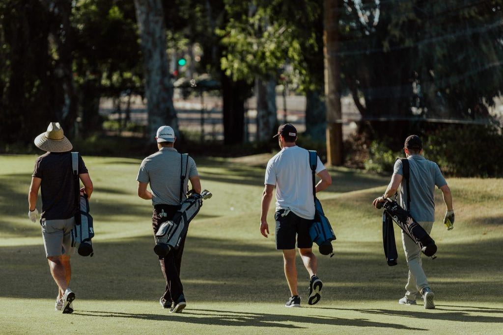 4 golfers on the course